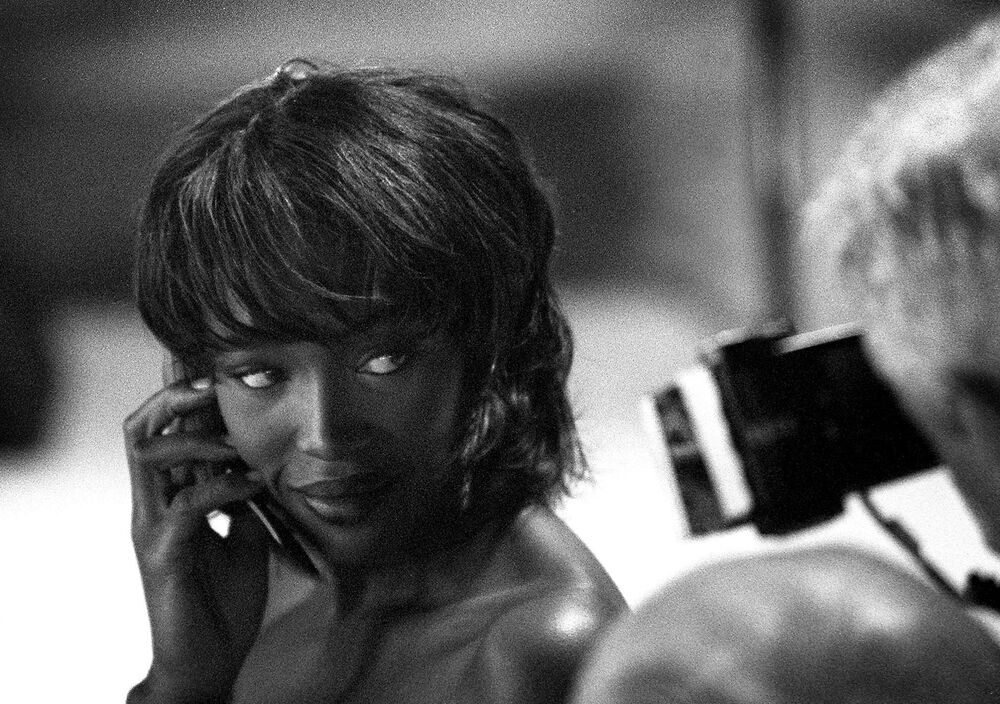 Naomi Campbell poses behind the scenes of Matthew Williamson's Spring/Summer 2000 fashion show