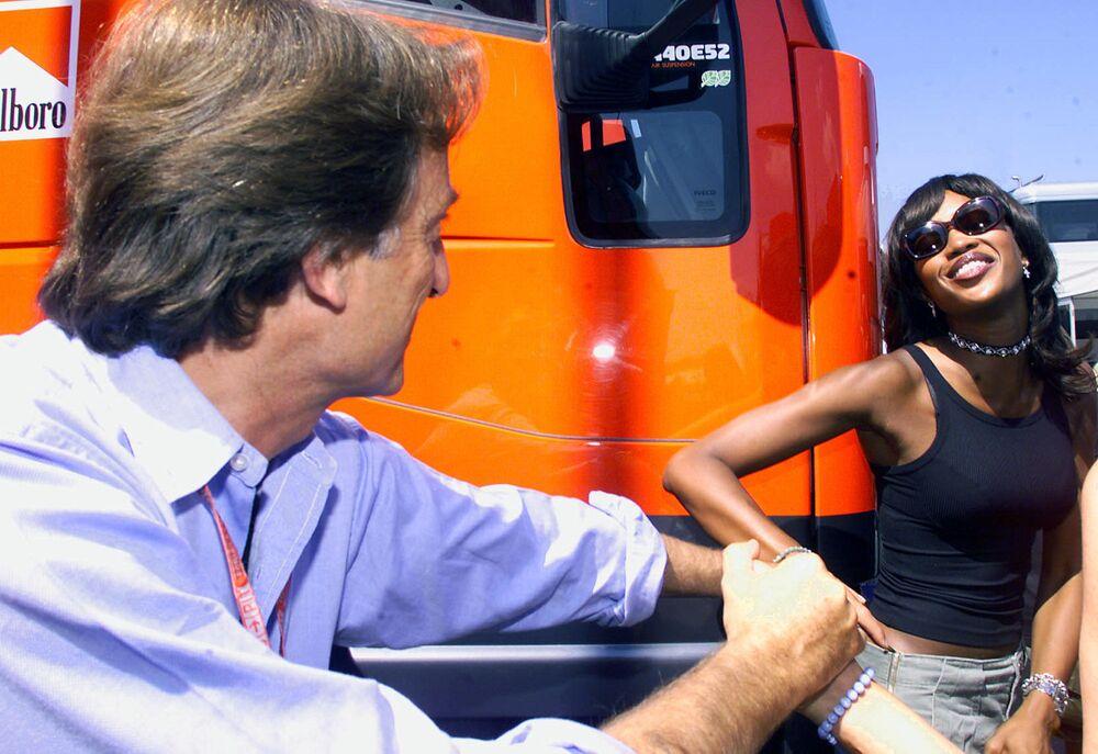 Naomi Campbell poses to Ferrari chairman Luca di Montezemolo at Formula 1 Grand Prix in Hungary, 2000