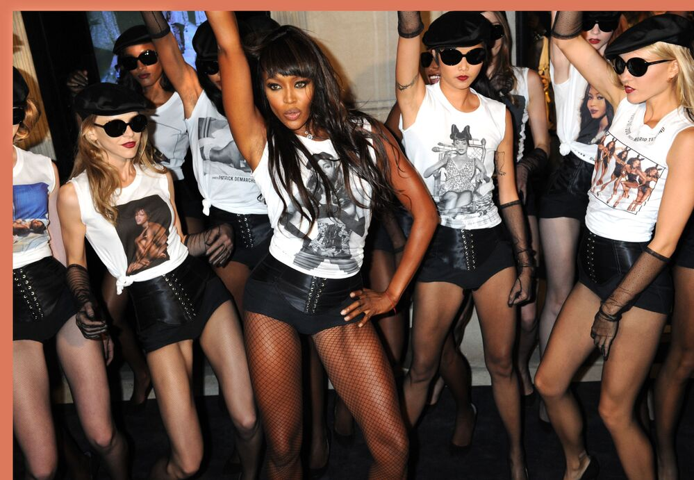Naomi Campbell celebrates 25 years of her career with other models in a Dolce&Gabbana store in New York City, 2010