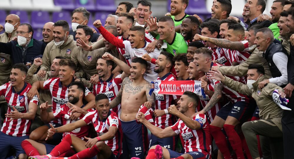 Atletico Madrid players celebrate at the end of the Spanish La Liga soccer match between Atletico Madrid and Valladolid at the Jose Zorrilla stadium in Valladolid, Spain, Saturday, May 22, 2021. Atletico won 2-1 and clinches its 11th Spanish La Liga title.