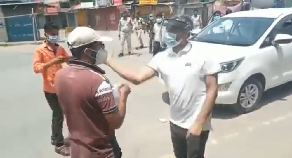 Shocking visuals from Surajpur in Chhattisgarh collector snatched phone, slapped a boy gone out to buy medicines, polices also caned him, FIR lodged against the boy