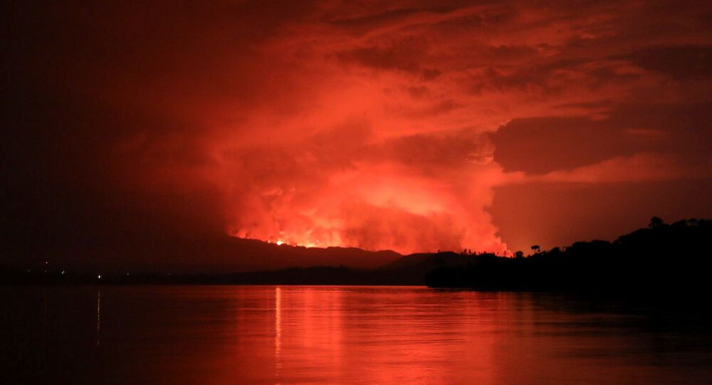 Smoke and flames are seen at the Nyiragongo volcanic eruption from the Tchegera Island on Lake Kivu, near Goma, in the Democratic Republic of Congo