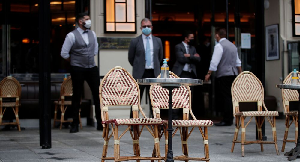 Tables are set on a terrace of a cafe during preparations for the reopening of restaurants and bars in Paris as part of an easing of the country's lockdown restrictions amid the coronavirus disease (COVID-19) outbreak in France, May 18, 2021.