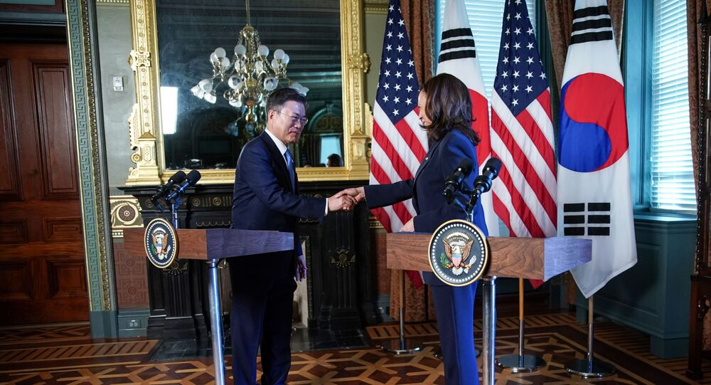 US Vice President Kamala Harris and South Korean President Moon Jae-in shake hands before participating in a bilateral meeting at the Eisenhower Executive Office Building near the White House in Washington, US, May 21, 2021