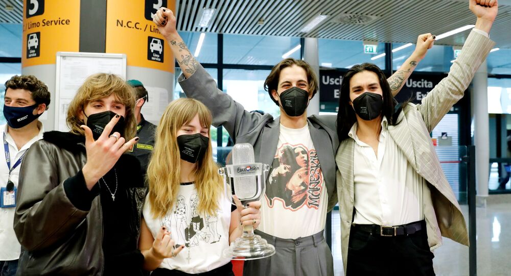 Members of Italian rock band Maneskin pose for a picture as they return to Italy following their 2021 Eurovision Song Contest victory, in Rome, Italy, May 23, 2021.