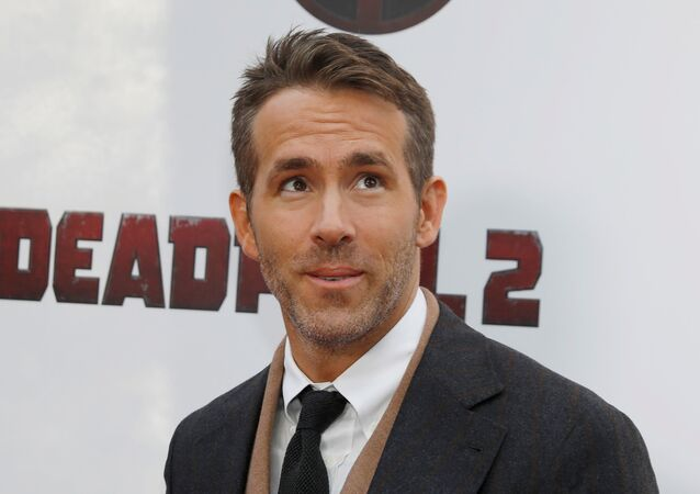 Actor Ryan Reynolds poses on the red carpet during the premiere of Deadpool 2 in Manhattan, New York, U.S., May 14, 2018.