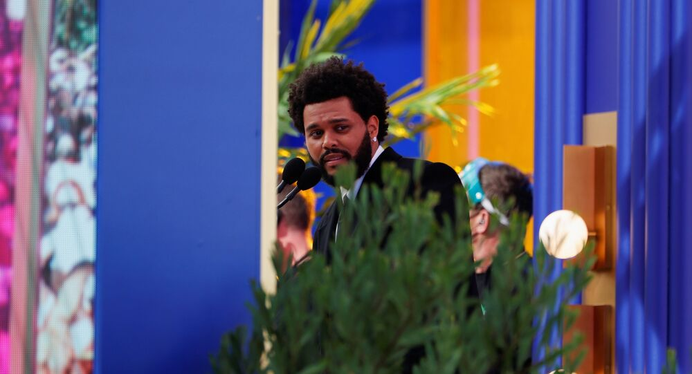 The Weeknd speaks after he won the award for Top Hot 100 Artist at the 2021 Billboard Music Awards outside the Microsoft Theater in Los Angeles, California, U.S. May 23, 2021