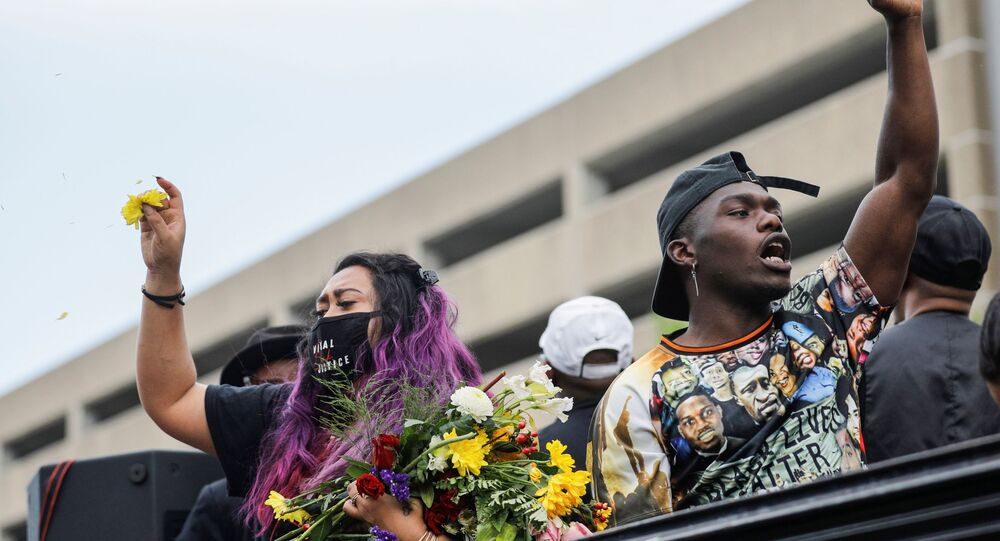 Tony B reacts while rapping from a truck as people march during the One Year, What's Changed? rally hosted by the George Floyd Global Memorial to commemorate the first anniversary of his death, in Minneapolis, Minnesota, U.S. May 23, 2021