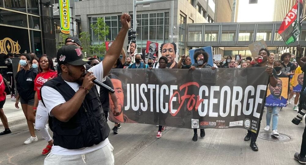 Several hundred Americans march through downtown Minneapolis paying tribute to George Floyd.