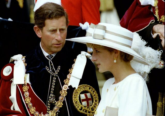 Prince Charles looks towards Princess Diana as they await their carriage to depart the Order of the Garter ceremony at Windsor Castle June 15, 1992