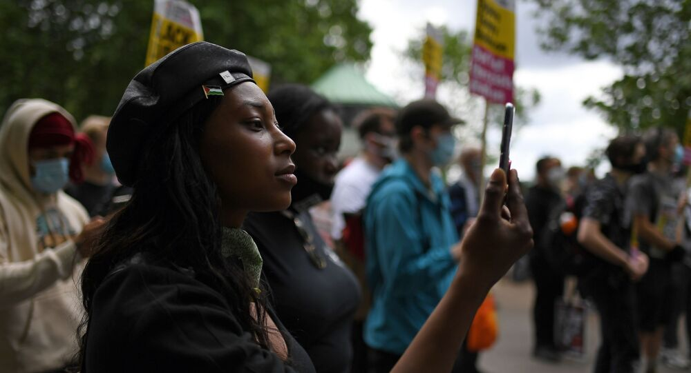 FILE - In this Saturday, June 13, 2020 file photo Sasha Johnson, of the Black Lives Matter movement attends a protest at Hyde Park in London