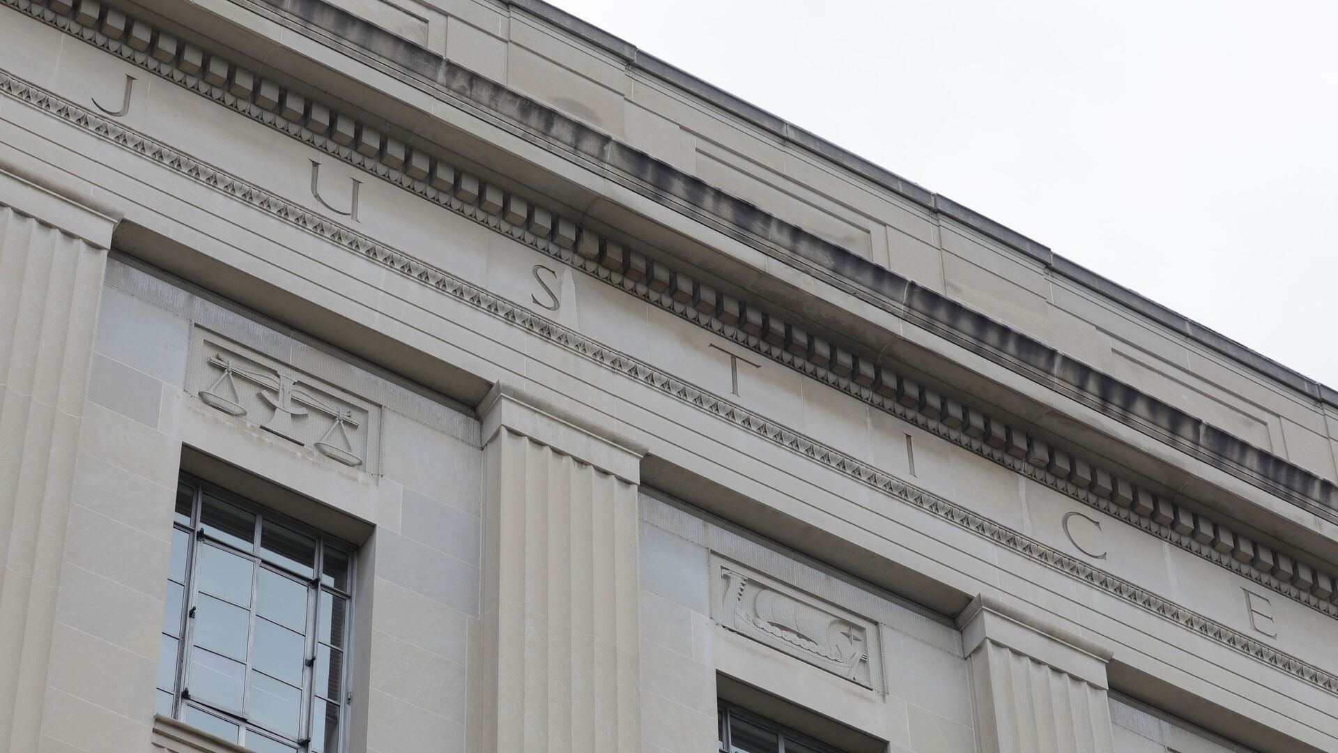 The word justice is seen engraved at the headquarters of the United States Department of Justice (DOJ) in Washington, D.C., U.S., May 10, 2021. - Sputnik International, 1920, 14.09.2021