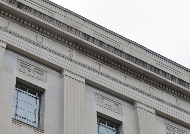 The word justice is seen engraved at the headquarters of the United States Department of Justice (DOJ) in Washington, D.C., U.S., May 10, 2021.