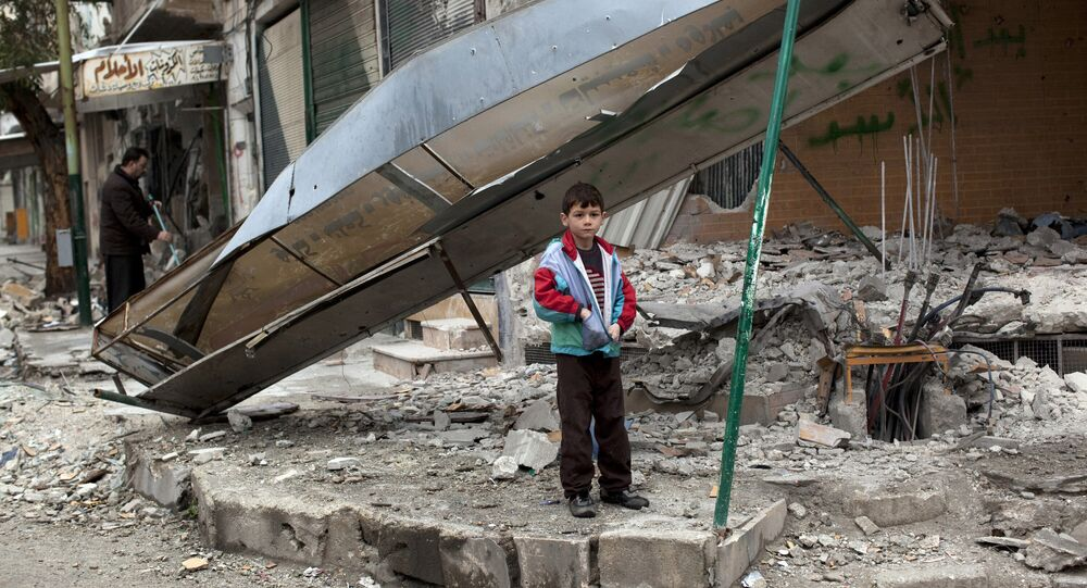 In this Monday, Feb. 27, 2012 file photo, a boy stands in from of a shop destroyed in Syrian Army shelling in the center of Idlib, in northern Syria.