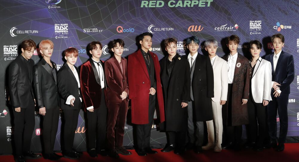 Members of the band Seventeen pose for photographers upon arrival at the Asian Music Awards in Nagoya, Japan Wednesday, Dec. 4, 2019