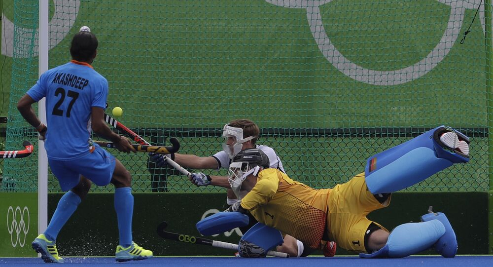 Germany's goalkeeper Nicolas Jacobi, center, looks for the ball enter his goal which scored by Indian player India's Rupinder Pal Singh during a men's field hockey match (File)