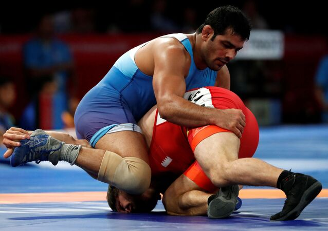 Sushil Kumar of India in action with Adam Batirov of Bahrain