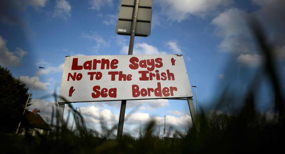 A sign is seen with a message against the Brexit border checks in relation to the Northern Ireland protocol near the harbour in Larne, Northern Ireland, 12 February 2021.