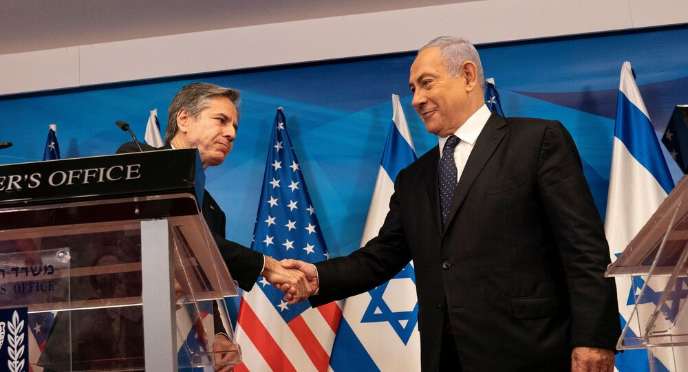 Israeli Prime Minister Benjamin Netanyahu and US Secretary of State Antony Blinken shake hands after a joint statement and meeting at the Prime Minister's office, in Jerusalem May 25, 2021