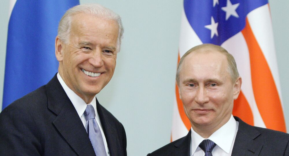 In this March 10, 2011 file photo, then Vice President  Joe Biden, left, shakes hands with Russian Prime Minister Vladimir Putin in Moscow, Russia.