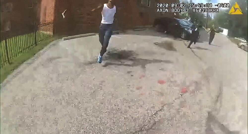 This image from video released by the Metropolitan Police Department, shows body cam video during a foot pursuit with Deon Kay, center, in Washington, on Wednesday afternoon, Sept. 2, 2020.