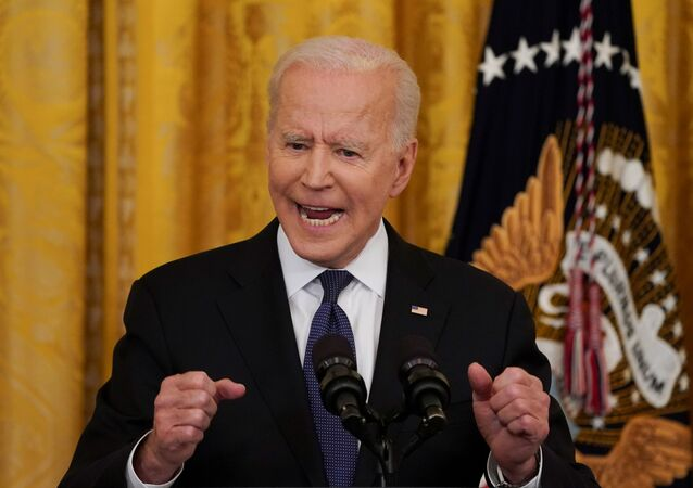 U.S. President Joe Biden gestures as he speaks before signing the COVID-19 Hate Crimes Act into law, in the East Room at the White House in Washington, U.S., May 20, 2021.