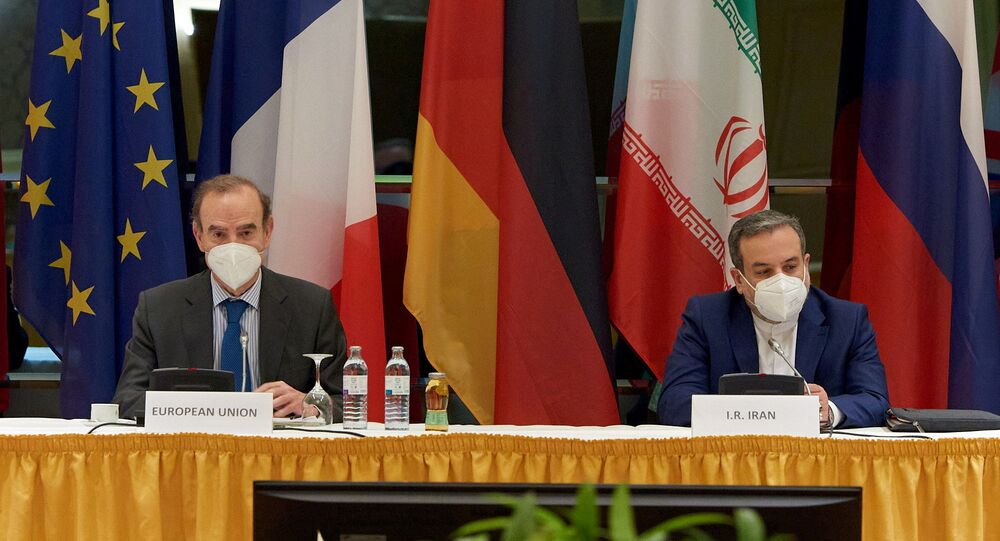 European External Action Service (EEAS) Deputy Secretary General Enrique Mora and Iranian Deputy at Ministry of Foreign Affairs Abbas Araghchi wait for the start of a meeting of the JCPOA Joint Commission in Vienna, Austria May 1, 2021