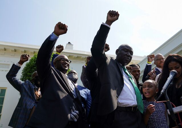 Gianna Floyd, daughter of George Floyd, along with other family members and lawyers, raise fists and say his name while facing reporters at the White House following their meeting with President Joe Biden in Washington, U.S., May 25, 2021