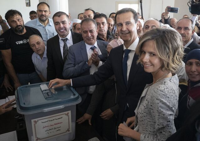 Syrian President Bashar Assad and his wife Asma vote at a polling station during the Presidential elections in the town of Douma, in the eastern Ghouta region, near the Syrian capital Damascus, Syria, Wednesday, 26 May, 2021.