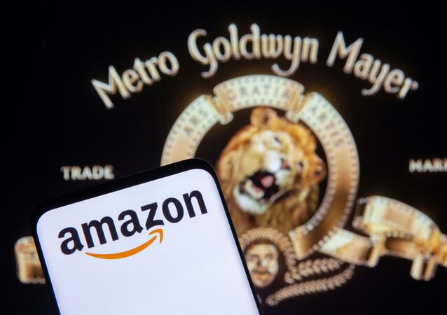 Smartphone with Amazon logo is seen in front of displayed MGM logo in this illustration taken, May 26, 2021