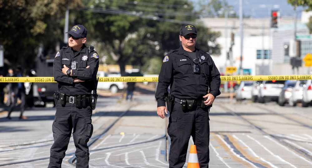 Police secure the scene of a mass shooting at a rail yard run by the Santa Clara Valley Transportation Authority in San Jose, California, 26 May 2021.
