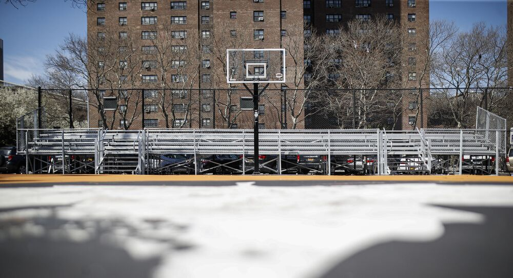 Basketball backboards stand without hoops after city officials had them removed to reduce gatherings at Holcombe Rucker Park, Thursday, March 26, 2020, in New York. Across the U.S., police departments are taking a lead role in enforcing social distancing rules that health officials say are critical to containing the coronavirus. In New York City, they've started dismantling basketball hoops to prevent people from gathering in parks and playing.