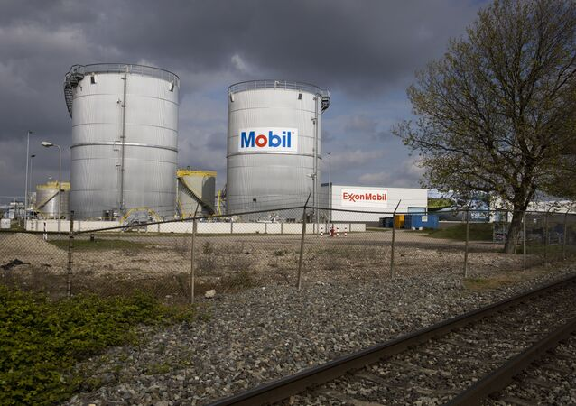 View of Exxon Mobil storage tanks of the petrochemical industry in the port of Rotterdam, Netherlands, Saturday, May 15, 2021.