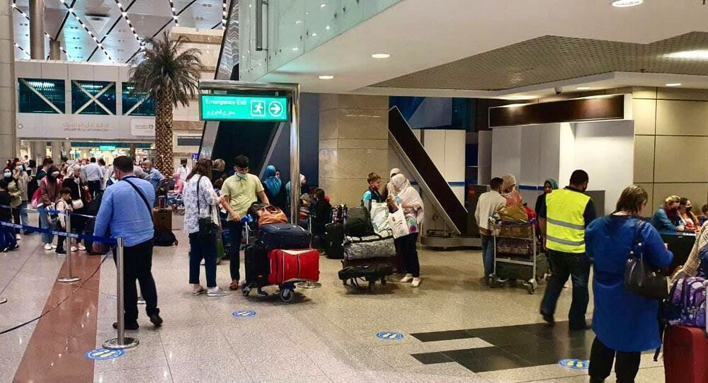 Russian citizens, mostly women and children, arrived from the Gaza Strip at Cairo International Airport