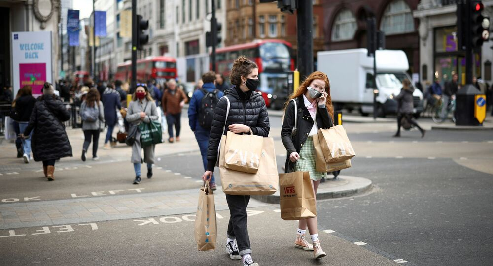 People walk at Oxford Street, as the coronavirus disease (COVID-19) restrictions ease, in London, Britain April 12, 2021