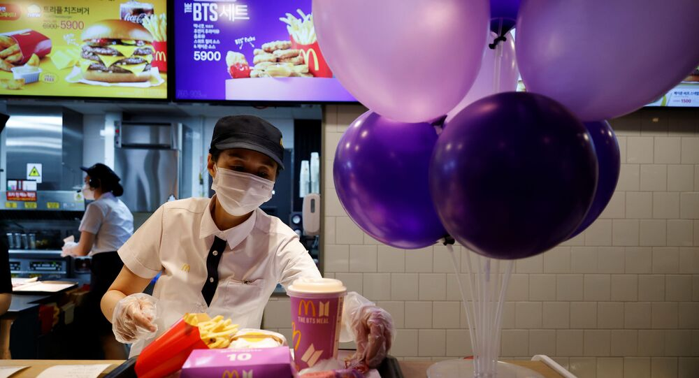 An employee of McDonald's serves a BTS meal, which is inspired and promoted by K-pop boy band BTS, during lunch hour at its restaurant in Seoul, South Korea, May 27, 2021