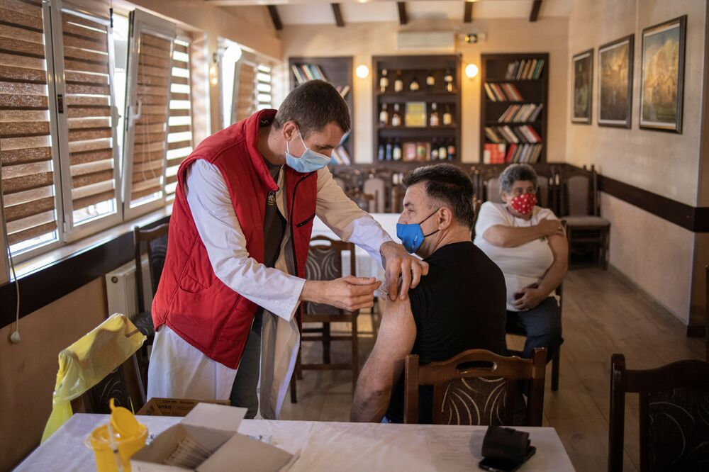 A man receives a dose of the Chinese Sinopharm vaccine against the coronavirus disease (COVID-19) at a restaurant in Kragujevac, Serbia.