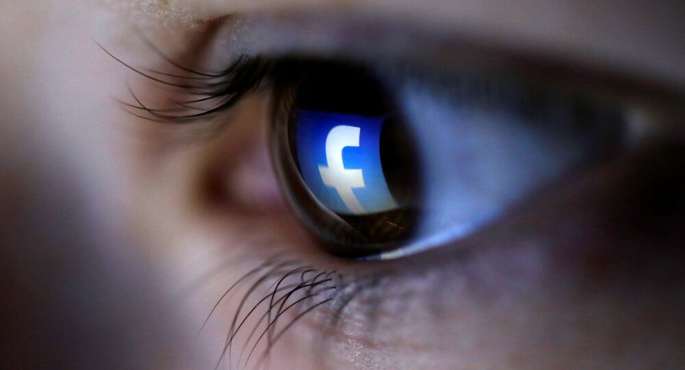 A picture illustration shows a Facebook logo reflected in a person's eye, in Zenica, March 13, 2015