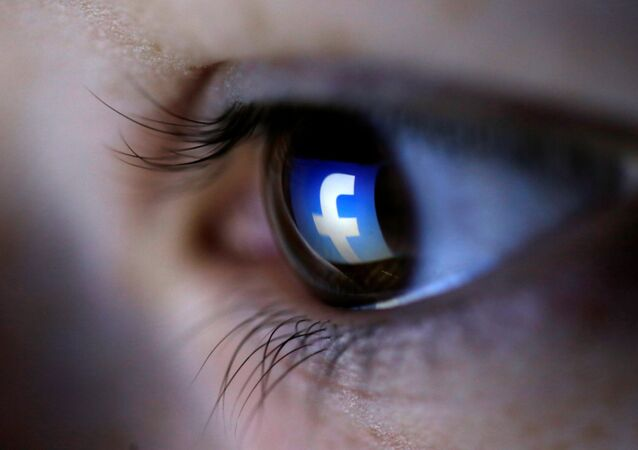 A picture illustration shows a Facebook logo reflected in a person's eye, in Zenica, 13 March 2015