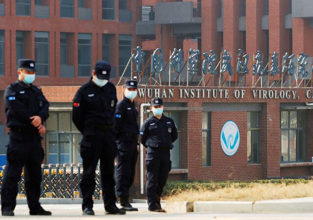 Security personnel keep watch outside Wuhan Institute of Virology during the visit by the World Health Organization (WHO) team tasked with investigating the origins of the coronavirus disease (COVID-19), in Wuhan, Hubei province, China February 3, 2021