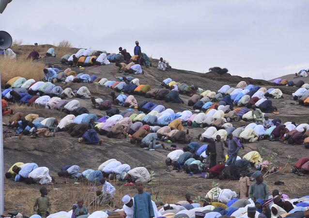 Muslims perform an Eid al-Fitr prayer in an outdoor area in Bauchi, Nigeria on Thursday, 13 May 2021.
