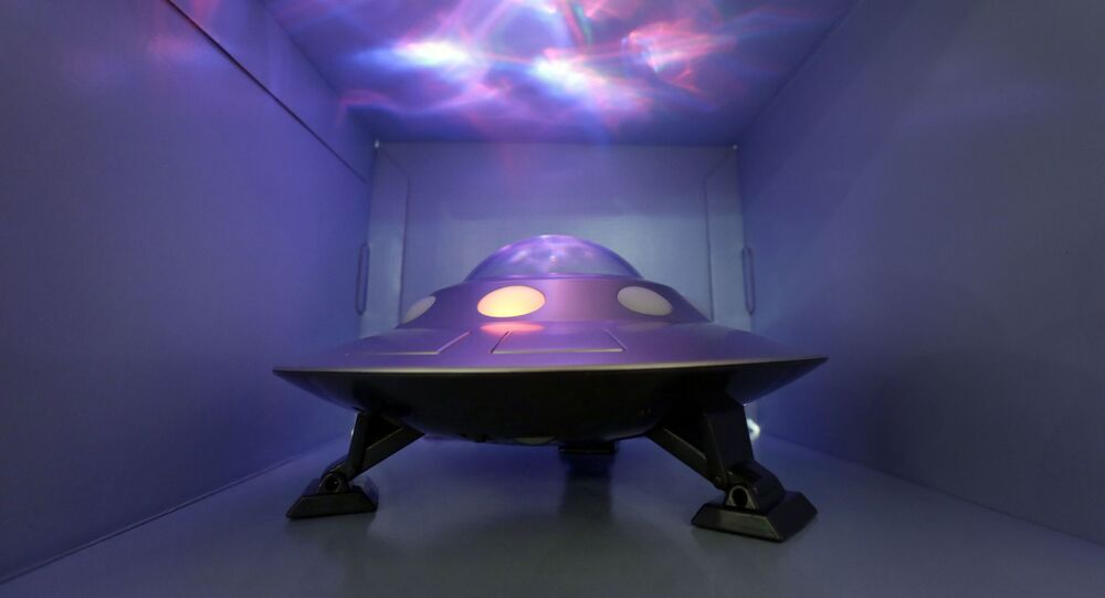 The Cosmic UFO, by Cloud b, that features moving projections of the Norther Lights, is demonstrated at the TTPM Holiday Showcase, in New York, Wednesday, Oct. 1, 2014.