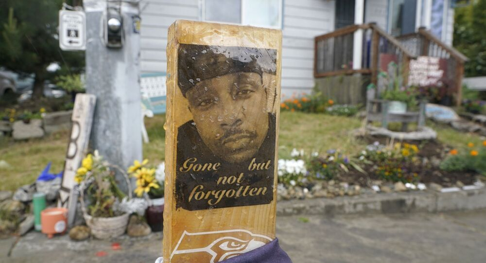 A sign that reads Gone but not forgotten is shown on a cross displayed Thursday, May 27, 2021, at a memorial that has been established at the intersection in Tacoma, Wash., south of Seattle, where Manuel Manny Ellis died on March 3, 2020, after he was restrained by police officers.