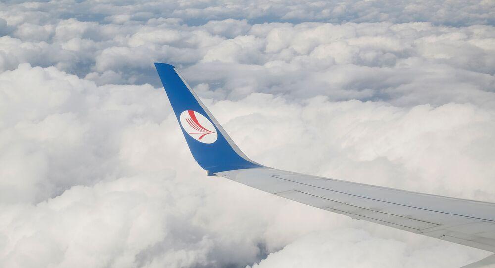 A wing of a plane of Belavia company is seen over clouds near Minsk, Belarus, July 19, 2016.