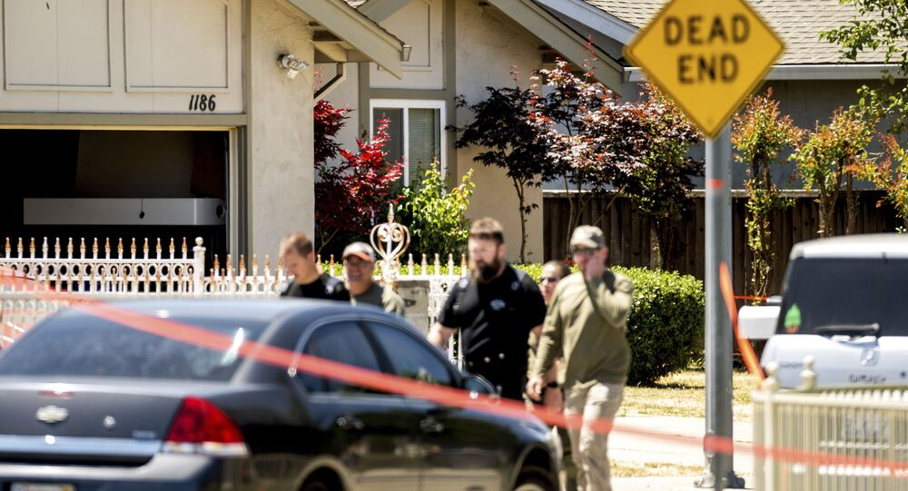 Emergency responders leave a home, rear, being investigated in connection to a shooting at a Santa Clara Valley Transportation Authority (VTA) facility, Wednesday, May 26, 2021, in San Jose, Calif.