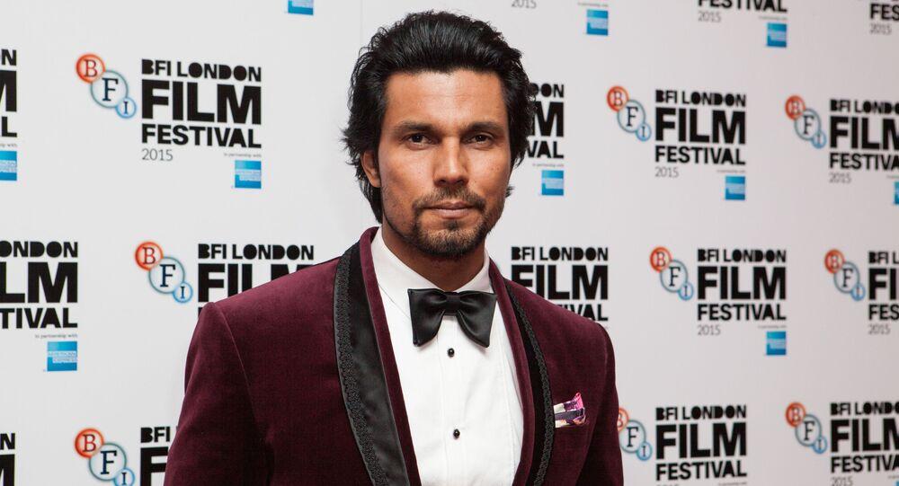 Actor Randeep Hooda poses for photographers upon arrival at the Premiere of the film Beeba Boys, showing as part of the London Film Festival, in central London, Thursday, Oct. 8, 2015