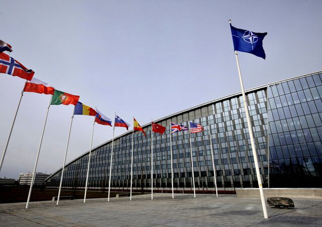Flags of Alliance members flap in the wind outside NATO headquarters in Brussels, Friday, Feb. 28, 2020