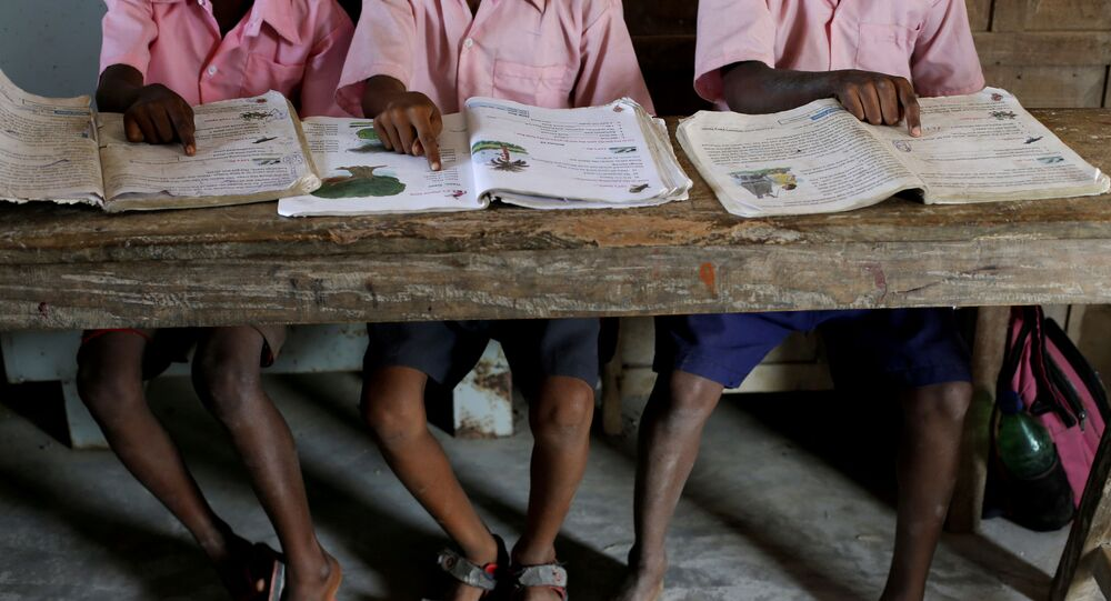 Students from a primary school read books inside a classroom on Ghoramara Island, India, November 16, 2018