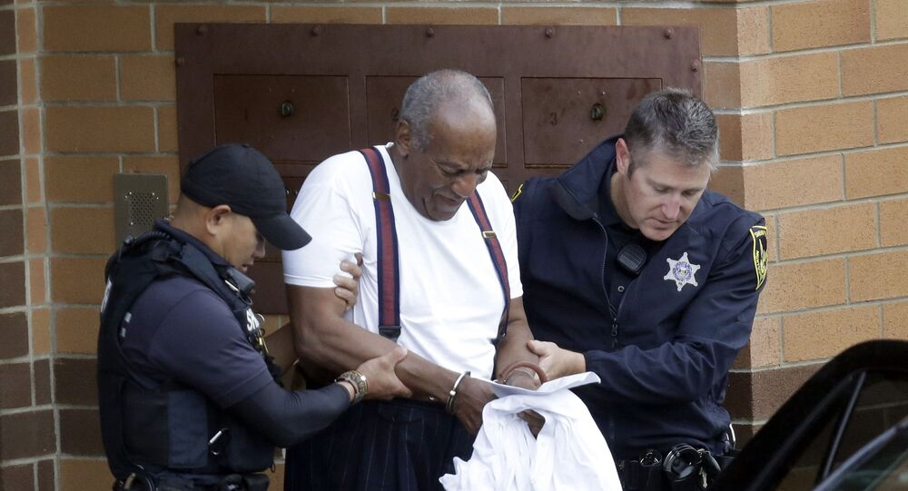 Bill Cosby is escorted out of the Montgomery County Correctional Facility, Tuesday Sept. 25, 2018, in Eagleville, Pa., following his sentencing to three-to-10-year prison sentence for sexual assault.