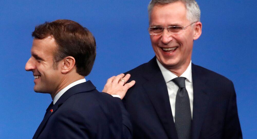FILE PHOTO: French President Emmanuel Macron and NATO Secretary General Jens Stoltenberg react at a NATO summit meeting n Watford, Britain December 4, 2019. REUTERS/Christian Hartmann/Pool/File Photo